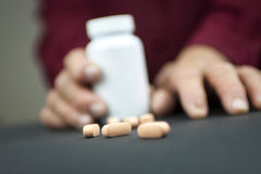 Rheumatoid Arthritis hands and pills Stock Photo