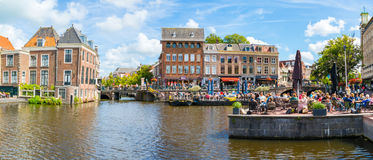 Rhine canal with people on outdoor cafes, Leiden, Netherlands royalty free stock image