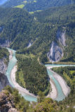 Rhine canyon near Flims Switzerland. Tight river bend filled with light blue water of Rhine Canyon in Switzerland seen from Flims Stock Photos
