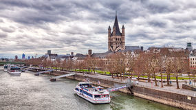 Rhine in Cologne with the Great St. Martin Church Stock Images