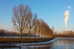 Rhine embankment and power plant. Karlsruhe Rhine embankment with power-plant and trees on the dyke Stock Photography
