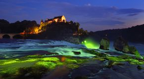 Rhine Falls at the blue hour. The Rhine Falls at the blue hour with a view of the castle Laufen Stock Image