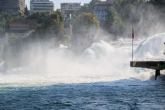 The Rhine Falls is the largest waterfall in Europe in Schaffhausen, Switzerland. Summer landscape, sunshine weather, blue sky and sunny day royalty free stock photos