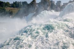 The Rhine Falls is the largest waterfall in Europe in Schaffhausen, Switzerland. Summer landscape, sunshine weather, blue sky and sunny day royalty free stock photography