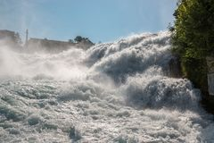 The Rhine Falls is the largest waterfall in Europe in Schaffhausen, Switzerland. Summer landscape, sunshine weather, blue sky and sunny day stock image