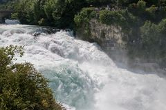The Rhine Falls is the largest waterfall in Europe in Schaffhausen, Switzerland. Summer landscape, sunshine weather, blue sky and sunny day stock photography