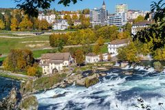 The Rhine Falls near Zurich at Indian summer, waterfall in Switz. The Rhine Falls near Zurich at Indian summer, largest waterfall in Switzerland Royalty Free Stock Photos