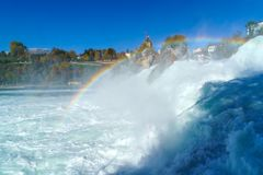 The Rhine Falls near Zurich at Indian summer, waterfall in Switz. The Rhine Falls near Zurich at Indian summer, largest waterfall in Switzerland Stock Photo