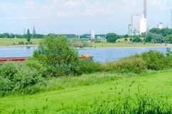 Rhine landscape. Beautiful Rhine landscape with views of a power plant in a green environment Stock Photos