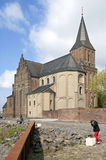 Rhine promenade with church, child and kitten Royalty Free Stock Photos