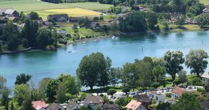 Rhine river, aerial view. Aerial view of the upper Rhine valley on the Swiss – German border near the city of Stein am Rhein on a beautifully sunny late spring stock footage