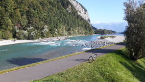 The rhine river and bicycle on the bicycle path. In sarans switzerland Royalty Free Stock Image
