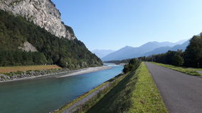The Rhine river and bike path. In Sargans Switzerland Royalty Free Stock Photo