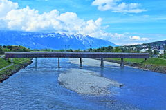 Rhine river Vaduz. Old bridge over the Rhine in Vaduz Stock Photography