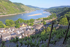 Rhine valley from above. Picturesque view from the vineyards over the Upper Middle Rhine Valley and the village of Bacharach, Germany. The 65 km long Upper royalty free stock photo