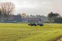 Rhine valley farmer fertilizing field before winter. Bei Old Rhine - Altach, Vorarlberg, Austria stock photography
