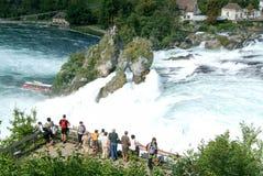 The Rhine waterfalls at Neuhausen on Switzerland. Neuhausen, Switzerland - 26 August 2008: People enjoying the view at  the Rhine waterfalls at Neuhausen on Royalty Free Stock Photo