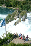 The Rhine waterfalls at Neuhausen on Switzerland. Neuhausen, Switzerland - 26 August 2008: People enjoying the view at the top of the rock that stands in the Stock Images