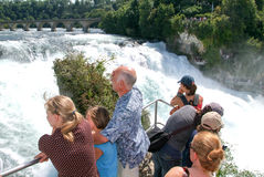 The Rhine waterfalls at Neuhausen on Switzerland. Neuhausen, Switzerland - 26 August 2008: People enjoying the view at the top of the rock that stands in the Royalty Free Stock Photo