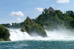 The Rhine waterfalls at Neuhausen on Switzerland. Neuhausen, Switzerland - 26 August 2008: People enjoying the view at the top of the rock that stands in the Stock Photo