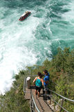 The Rhine waterfalls at Neuhausen on Switzerland. Neuhausen, Switzerland - 26 August 2008: people going up the stairs to the top of the rock that stands in the Royalty Free Stock Photos