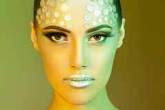 Rhinestone fashion make up green and yellow toned image Stock Photography