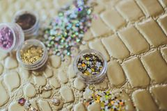 Rhinestones for the decoration of nails royalty free stock images