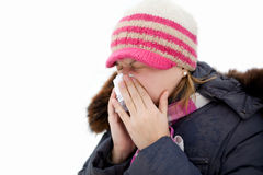 Rhinitis. A cold girl, and a handkerchief, in the winter flu Royalty Free Stock Photo
