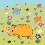 Rhino and animals on land Stock Image