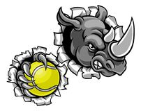 Rhino Holding Tennis Ball Breaking Background. A rhino tennis animal sports mascot holding a ball and breaking through the background with its claws Royalty Free Stock Photography