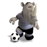 Rhino plays soccer / football. Funny rhino plays soccer. With Clipping Path Stock Photo
