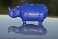 Rhino shaped money box. Blue rhino-shaped money box Stock Images