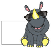 Rhino sit near the clean paper Royalty Free Stock Images