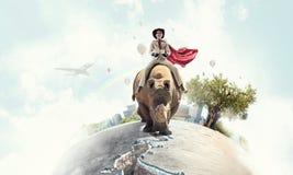Rhinocéros d'équitation de femme d'affaires Media mélangé Photo stock
