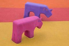 Rhinoceros animal toy in the playground Royalty Free Stock Photos