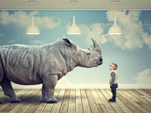 Rhinoceros and kid Royalty Free Stock Image