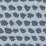 Rhinos vector. Seamless background pattern of rhinoceroses. Wild nature. Rhino icon. Royalty Free Stock Images