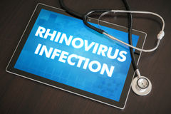 Rhinovirus infection (infectious disease) diagnosis medical. Concept on tablet screen with stethoscope Royalty Free Stock Image