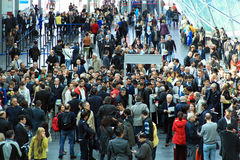 Rho Fiera, people crowd. People crowd enter Rho Fiera to visit Salone Internazionale del Mobile, international home furnishing accessories and interiors design Stock Photo