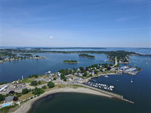 Rhode Island and Bay USA. View on sunny day looking north from Portsmouth, RI - includes Bristol RI and Mt. Hope Bridge and BlueBell Cove Stock Image