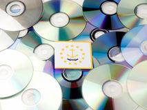 Rhode Island flag on top of CD and DVD pile isolated on white Stock Image