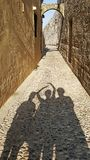 Rhodes Ancient Steet Daytime. With three peoples shadow stock image