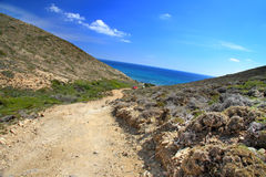 Rhodes.dirt road on a mountain slope. Royalty Free Stock Images