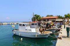 Small sea port with moored fishing boats on Rhodes island, Greece Royalty Free Stock Photos