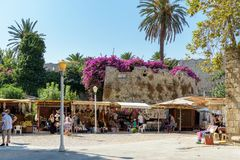 Small souvenir shops near old fortress walls at Rhodes town on Rhodes island, Greece. RHODES, GREECE - AUGUST 2017: Small souvenir shops near old fortress walls Royalty Free Stock Photo