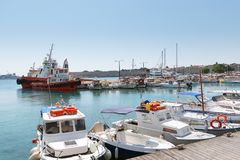 Traditional Greek boats are moored in port of Rhodes town on Rhodes island. Stock Images