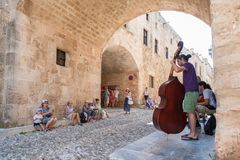 Rhodes,Greece. May 30, 2018. Buskers on The Street of the Knights playing for tourists. Old Town, Island of Rhodes, Greece, Europe royalty free stock image