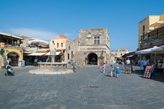 Rhodes, Greece. May 30, 2018. Hippocrates Square with Owl fountain. Great choice of restaurants stock photos