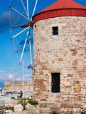 Rhodes,greece old windmills in the port by the sea of aegean stock photo