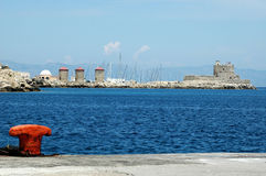 Rhodes harbor. Harbor of rhodes with red poller Stock Photos